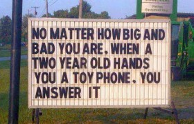 toy phone and a two year old sign